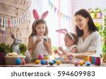 a mother and her daughter are... | Shutterstock . vector #594609983