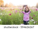 little asian girl in cosmos... | Shutterstock . vector #594626267