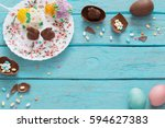 easter eggs over blue wooden... | Shutterstock . vector #594627383