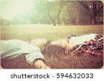 twins asian woman sleep on... | Shutterstock . vector #594632033