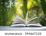 close up of open book at home... | Shutterstock . vector #594667133