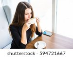 woman drinking coffee or tea in ... | Shutterstock . vector #594721667