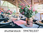 Flower Arrangement In A Vase A...