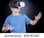 amazed teen boy wearing virtual ...   Shutterstock . vector #594787337