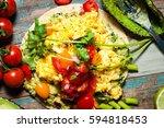 home made huevos rancheros. a... | Shutterstock . vector #594818453