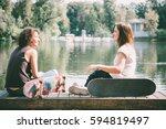 two young girls enjoy...   Shutterstock . vector #594819497