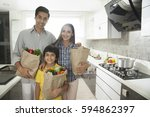 family carrying bags of... | Shutterstock . vector #594862397