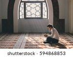 muslim man in a temple | Shutterstock . vector #594868853