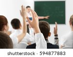 schoolchildren raising hands
