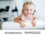cheerful adorable girl holding... | Shutterstock . vector #594902033
