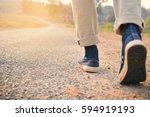 hipster feet a man and jeans... | Shutterstock . vector #594919193