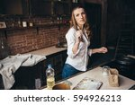 a girl in the kitchen sprinkles ... | Shutterstock . vector #594926213
