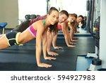 sporty people doing plank... | Shutterstock . vector #594927983