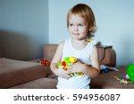 cute little boy being greedy. | Shutterstock . vector #594956087