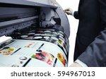 businessman is using the printer | Shutterstock . vector #594967013