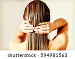 woman applying hair conditioner.... | Shutterstock . vector #594981563
