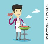 asian cheerful man cooking... | Shutterstock .eps vector #594994373
