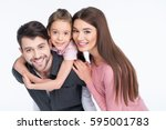 happy young family with one... | Shutterstock . vector #595001783