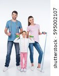 smiling young family with jump... | Shutterstock . vector #595002107