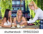 Female Waiter Serving Coffee T...