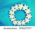white chips poker on turquoise... | Shutterstock . vector #595027577