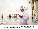 arabian man at sheikh zayed... | Shutterstock . vector #595070813