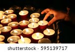 hand of the childwho lights a... | Shutterstock . vector #595139717