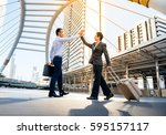 business man drag a luggage... | Shutterstock . vector #595157117