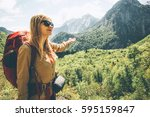 woman traveling in mountains... | Shutterstock . vector #595159847
