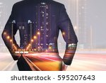 Small photo of Double exposure of businessman Back, looking ahead, light trails on the street and urban in the night as business and vision of leader concept.
