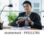 a man looks at the camera as he ... | Shutterstock . vector #595211783