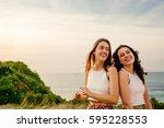 portrait of two female friends... | Shutterstock . vector #595228553