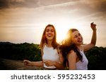 happy and funny female friends... | Shutterstock . vector #595232453