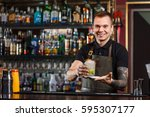 cheerful bartender gives the... | Shutterstock . vector #595307177