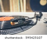 vinyl record on turntable... | Shutterstock . vector #595425107