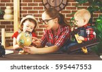 happy family of mother and... | Shutterstock . vector #595447553