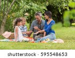 cheerful family sitting on the... | Shutterstock . vector #595548653