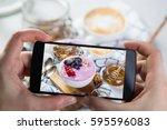 taking photos of breakfast to... | Shutterstock . vector #595596083