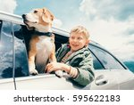 boy and dog look out from car... | Shutterstock . vector #595622183