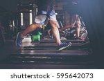 people running in machine... | Shutterstock . vector #595642073