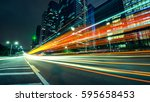 the light trails on the modern... | Shutterstock . vector #595658453