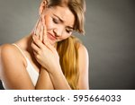 Small photo of Dental care and toothache. Young woman achy girl suffering from terrible tooth pain, touching pressing her cheek by hand palm.