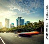 the light trails on the modern... | Shutterstock . vector #595683503