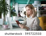 busy female freelancer reading... | Shutterstock . vector #595722533