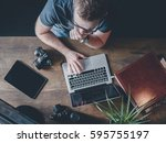 busy and focused young man... | Shutterstock . vector #595755197