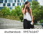 Cheerful Woman Talking Phone...