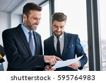 two businessmen discussing at... | Shutterstock . vector #595764983