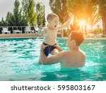 father and son funny in  water... | Shutterstock . vector #595803167