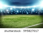 football pitch and blue lights  | Shutterstock . vector #595827017