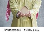 business islamic men holding...   Shutterstock . vector #595871117